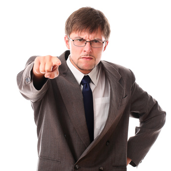 Very angry businessman pointing at the camera
